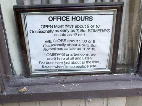 window sign with complicated listing of office hours